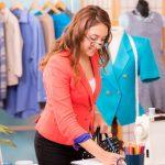 Female Tailor Holding Measuring Tape